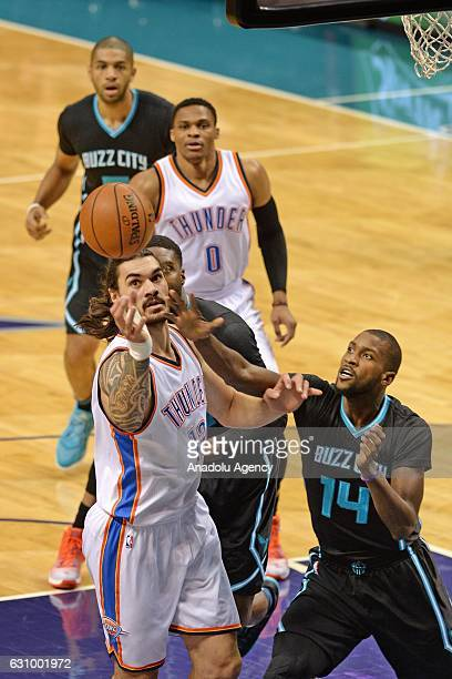Michael KiddGilchrist of Charlotte Hornets in action against Steven Adams of Oklahoma City Thunder during the NBA match between Oklahoma City Thunder...