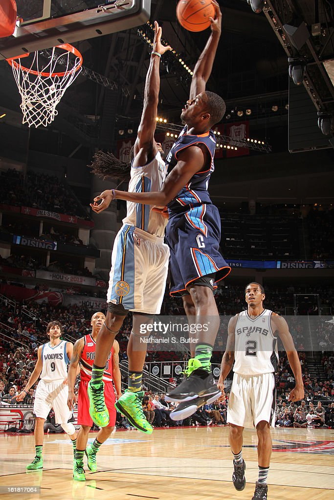Michael Kidd-Gilchrist #14 of Team Shaq shoots over <a gi-track='captionPersonalityLinkClicked' href=/galleries/search?phrase=Kenneth+Faried&family=editorial&specificpeople=5765135 ng-click='$event.stopPropagation()'>Kenneth Faried</a> #35 of Team Chuck during the 2013 BBVA Rising Stars Challenge at Toyota Center on February 15, 2013 in Houston, Texas.