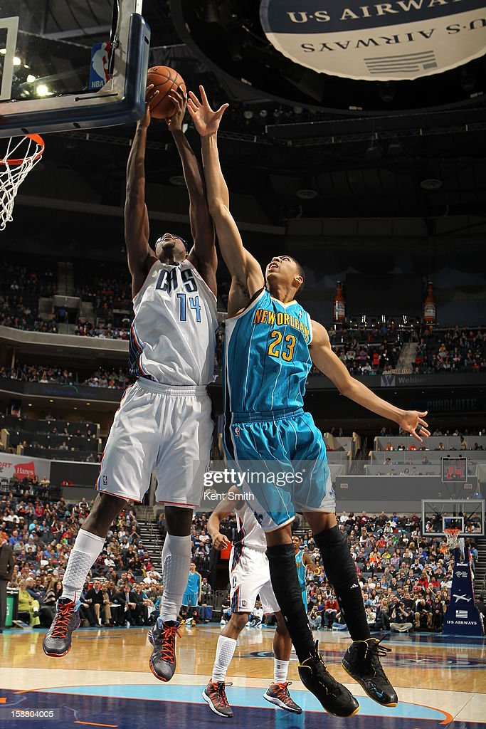Michael Kidd-Gilchrist #14 of the Charlotte Bobcats battles for the rebound against Anthony Davis #23 of the New Orleans Hornets at the Time Warner Cable Arena on December 29, 2012 in Charlotte, North Carolina.
