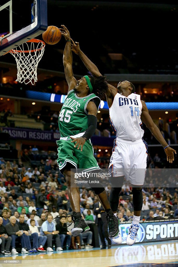 Michael Kidd-Gilchrist #14 of the Charlotte Bobcats blocks Gerald Wallace #45 of the Boston Celtics from behind during their game at Time Warner Cable Arena on November 25, 2013 in Charlotte, North Carolina.