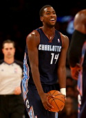 Michael KiddGilchrist of the Charlotte Bobcats celebrates late in the fourth quarter against the New York Knicks at Madison Square Garden on November...