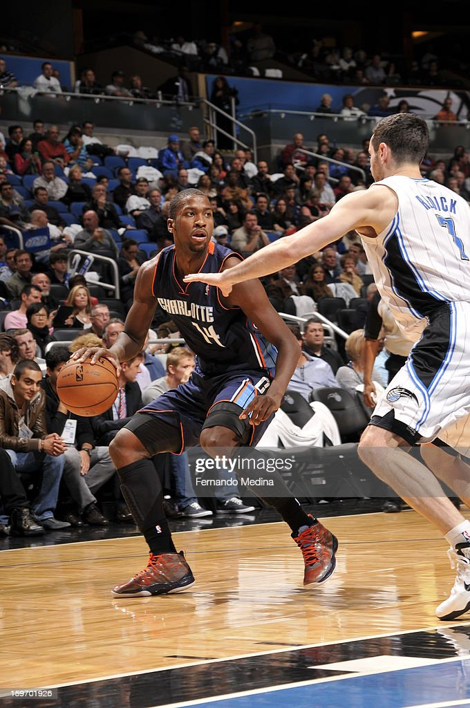 Michael Kidd-Gilchrist #14 of the Charlotte Bobcats controls the ball against J.J. Redick #7 of the Orlando Magic on January 18, 2013 at Amway Center in Orlando, Florida.