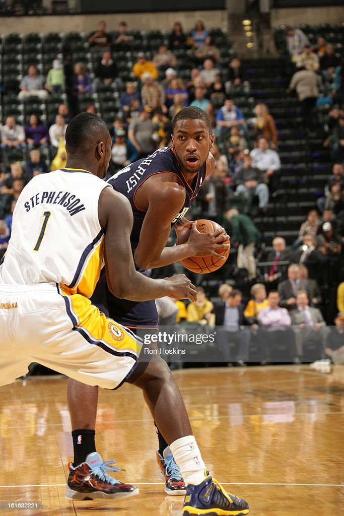 Michael Kidd-Gilchrist #14 of the Charlotte Bobcats controls the ball against Lance Stephenson #1 of the Indiana Pacers on February 13, 2013 at Bankers Life Fieldhouse in Indianapolis, Indiana.