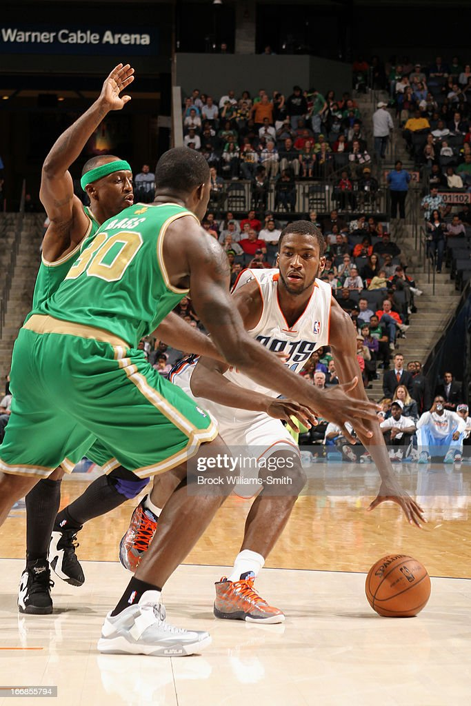 <a gi-track='captionPersonalityLinkClicked' href=/galleries/search?phrase=Michael+Kidd-Gilchrist&family=editorial&specificpeople=8526214 ng-click='$event.stopPropagation()'>Michael Kidd-Gilchrist</a> #14 of the Charlotte Bobcats dribbles the ball against the Boston Celtics at the Time Warner Cable Arena on March 12, 2013 in Charlotte, North Carolina.