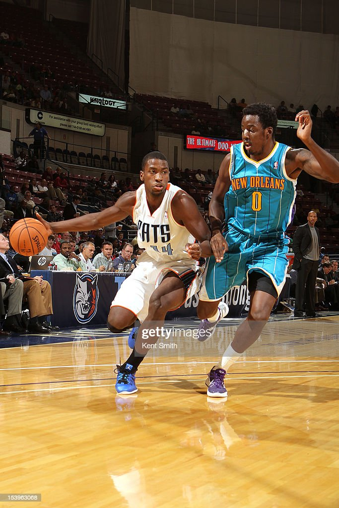 <a gi-track='captionPersonalityLinkClicked' href=/galleries/search?phrase=Michael+Kidd-Gilchrist&family=editorial&specificpeople=8526214 ng-click='$event.stopPropagation()'>Michael Kidd-Gilchrist</a> #14 of the Charlotte Bobcats drives against <a gi-track='captionPersonalityLinkClicked' href=/galleries/search?phrase=Al-Farouq+Aminu&family=editorial&specificpeople=5042446 ng-click='$event.stopPropagation()'>Al-Farouq Aminu</a> #0 of the New Orleans Hornets at the North Charleston Coliseum on October 11, 2012 in North Charleston, South Carolina.