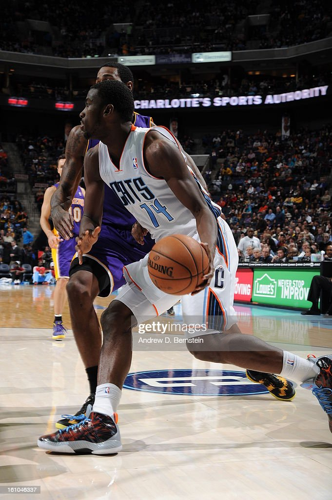 <a gi-track='captionPersonalityLinkClicked' href=/galleries/search?phrase=Michael+Kidd-Gilchrist&family=editorial&specificpeople=8526214 ng-click='$event.stopPropagation()'>Michael Kidd-Gilchrist</a> #14 of the Charlotte Bobcats drives against the Los Angeles Lakers on February 8, 2013 at the Time Warner Cable Arena in Charlotte, North Carolina.