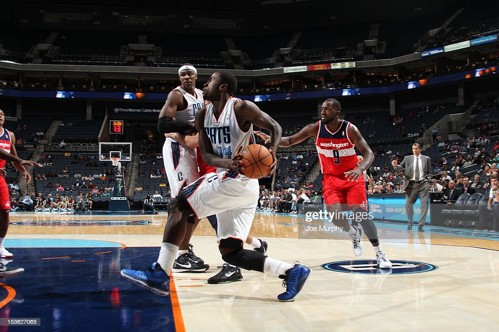 Michael Kidd-Gilchrist #14 of the Charlotte Bobcats drives the ball during the game between the Charlotte Bobcats and the Washington Wizards at the Time Warner Cable Arena on October 7, 2012 in Charlotte, North Carolina.