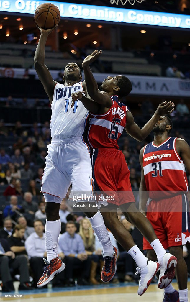 Michael Kidd-Gilchrist #14 of the Charlotte Bobcats drives to the basket against Jordan Crawford #15 of the Washington Wizards during their game at Time Warner Cable Arena on November 13, 2012 in Charlotte, North Carolina.