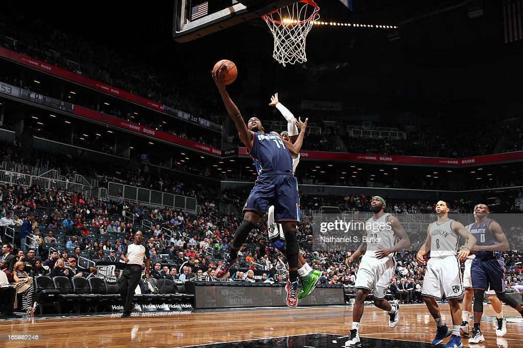 Michael Kidd-Gilchrist #14 of the Charlotte Bobcats drives to the basket against Gerald Wallace #45 of the Brooklyn Nets on April 6, 2013 at the Barclays Center in the Brooklyn borough of New York City.