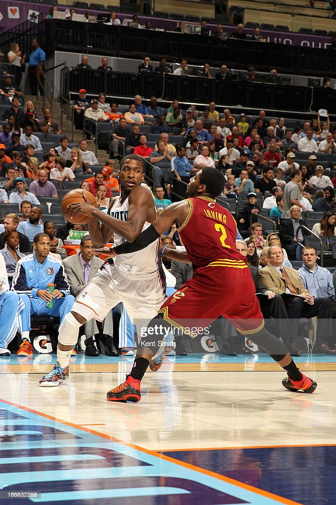 Michael Kidd-Gilchrist #14 of the Charlotte Bobcats drives to the basket against Kyrie Irving #2 of the Cleveland Cavaliers at the Time Warner Cable Arena on April 17, 2013 in Charlotte, North Carolina.