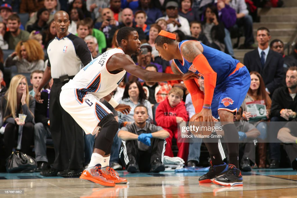 Michael Kidd-Gilchrist #14 of the Charlotte Bobcats faces off against Carmelo Anthony #7 of the New York Knicks during the game at the Time Warner Cable Arena on November 8, 2013 in Charlotte, North Carolina.