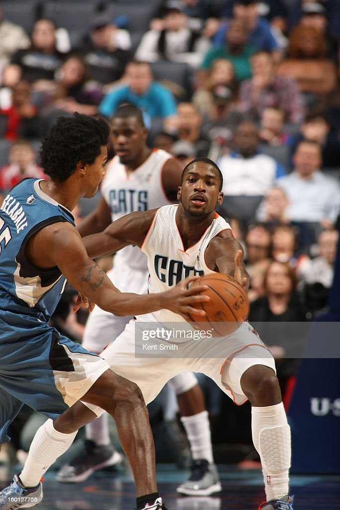 Michael Kidd-Gilchrist #14 of the Charlotte Bobcats goes for the grab against Mickael Gelabale #15 of the Minnesota Timberwolves at the Time Warner Cable Arena on January 26, 2013 in Charlotte, North Carolina.