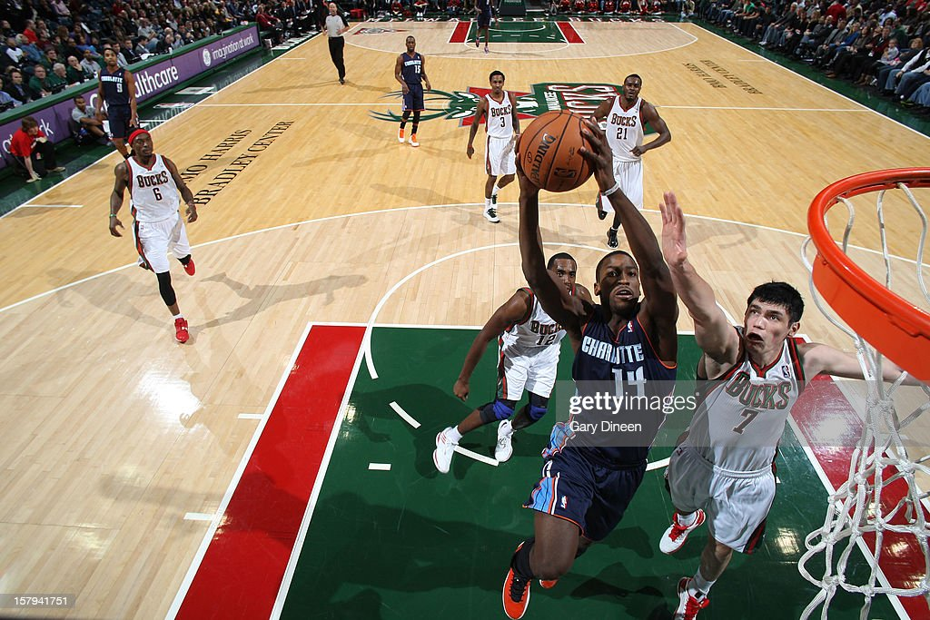 Michael Kidd-Gilchrist #14 of the Charlotte Bobcats goes to the basket against Ersan Ilyasova #7 of the Milwaukee Bucks during the game on December 7, 2012 at the BMO Harris Bradley Center in Milwaukee, Wisconsin.