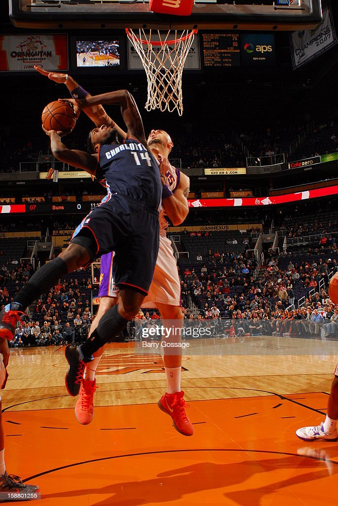 <a gi-track='captionPersonalityLinkClicked' href=/galleries/search?phrase=Michael+Kidd-Gilchrist&family=editorial&specificpeople=8526214 ng-click='$event.stopPropagation()'>Michael Kidd-Gilchrist</a> #14 of the Charlotte Bobcats goes to the basket against <a gi-track='captionPersonalityLinkClicked' href=/galleries/search?phrase=Marcin+Gortat&family=editorial&specificpeople=589986 ng-click='$event.stopPropagation()'>Marcin Gortat</a> #4 of the Phoenix Suns on December 19, 2012 at U.S. Airways Center in Phoenix, Arizona.