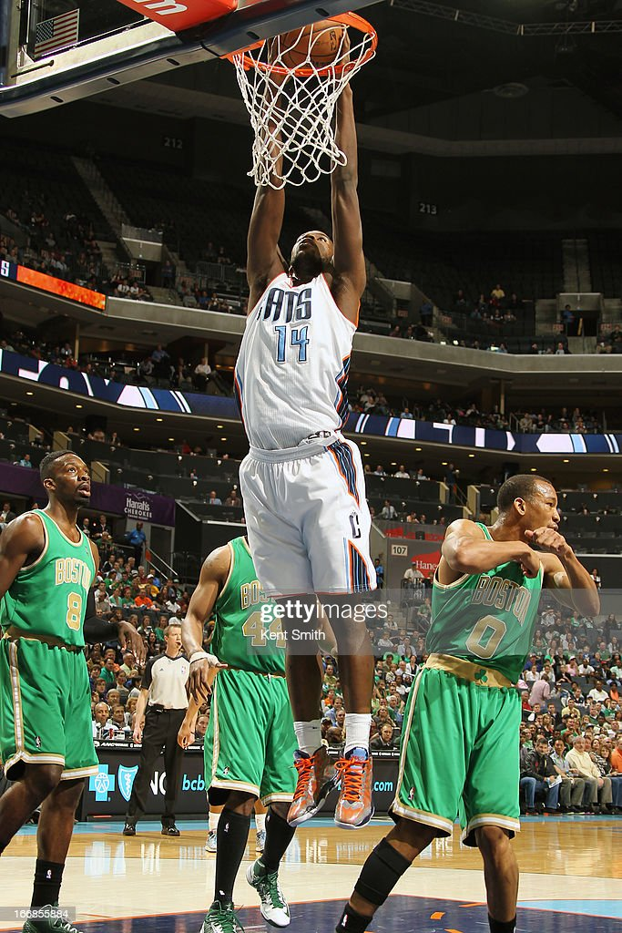 <a gi-track='captionPersonalityLinkClicked' href=/galleries/search?phrase=Michael+Kidd-Gilchrist&family=editorial&specificpeople=8526214 ng-click='$event.stopPropagation()'>Michael Kidd-Gilchrist</a> #14 of the Charlotte Bobcats goes up for the dunk against the Boston Celtics at the Time Warner Cable Arena on March 12, 2013 in Charlotte, North Carolina.