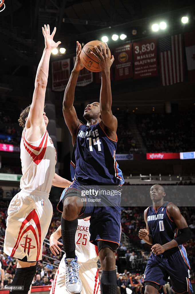 Michael Kidd-Gilchrist #14 of the Charlotte Bobcats goes up to the basket against the Houston Rockets on February 2, 2013 at the Toyota Center in Houston, Texas.