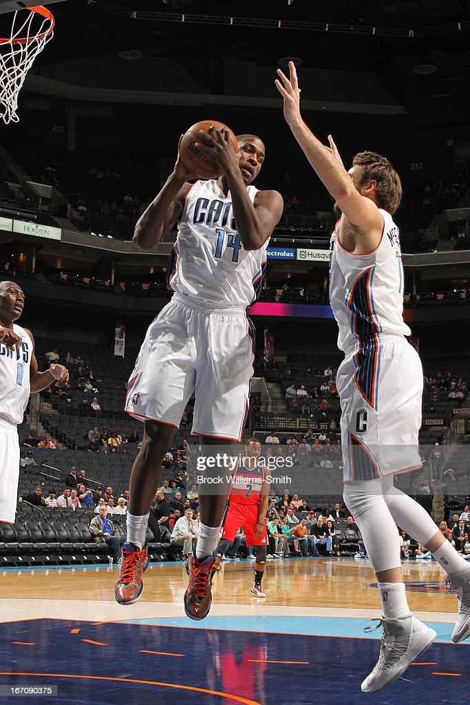 <a gi-track='captionPersonalityLinkClicked' href=/galleries/search?phrase=Michael+Kidd-Gilchrist&family=editorial&specificpeople=8526214 ng-click='$event.stopPropagation()'>Michael Kidd-Gilchrist</a> #14 of the Charlotte Bobcats grabs the rebound against the Washington Wizards at the Time Warner Cable Arena on March 18, 2013 in Charlotte, North Carolina.