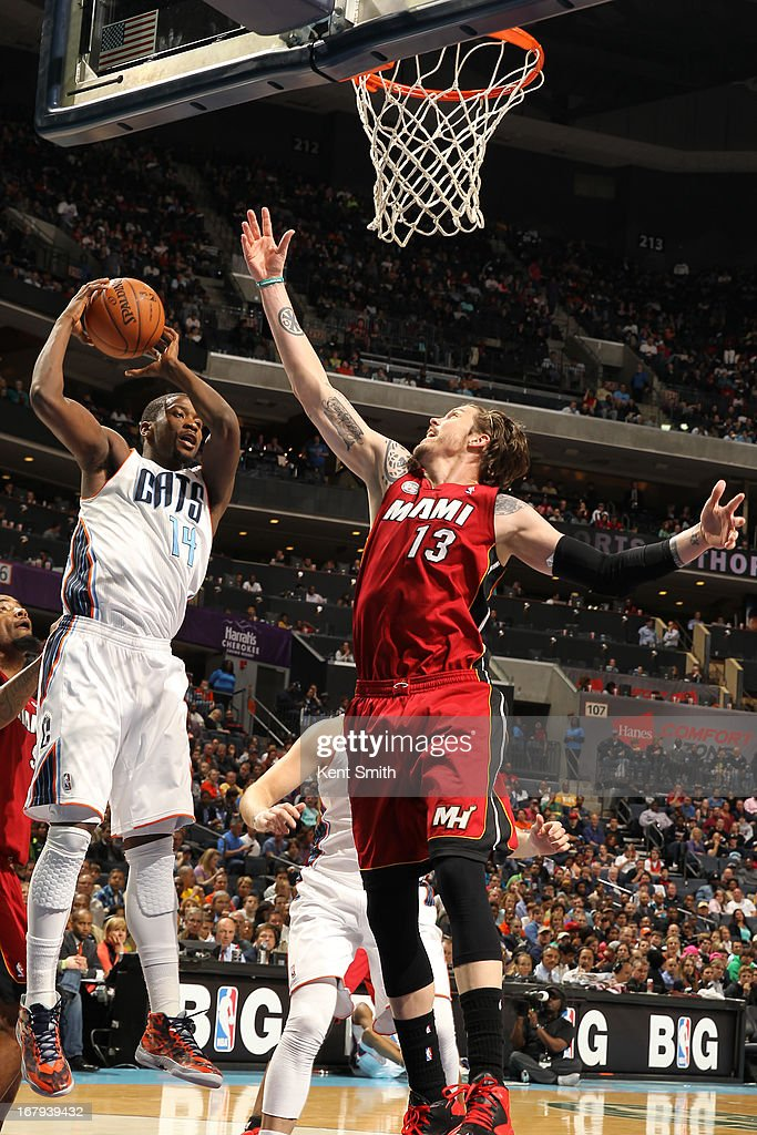 <a gi-track='captionPersonalityLinkClicked' href=/galleries/search?phrase=Michael+Kidd-Gilchrist&family=editorial&specificpeople=8526214 ng-click='$event.stopPropagation()'>Michael Kidd-Gilchrist</a> #14 of the Charlotte Bobcats grabs the rebound against the Miami Heat at the Time Warner Cable Arena on April 5, 2013 in Charlotte, North Carolina.