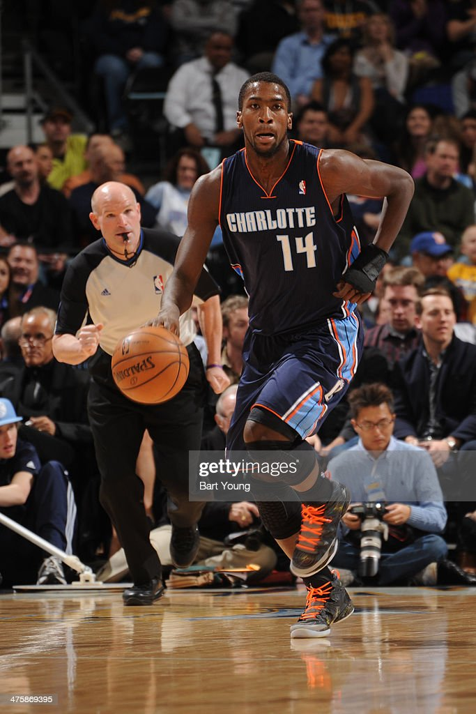 <a gi-track='captionPersonalityLinkClicked' href=/galleries/search?phrase=Michael+Kidd-Gilchrist&family=editorial&specificpeople=8526214 ng-click='$event.stopPropagation()'>Michael Kidd-Gilchrist</a> #14 of the Charlotte Bobcats handles the ball against the Denver Nuggets on January 29, 2014 at the Pepsi Center in Denver, Colorado.