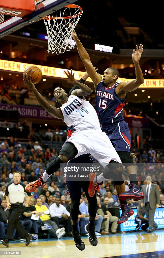 Michael Kidd-Gilchrist #14 of the Charlotte Bobcats is fouled by Al Horford #15 of the Atlanta Hawks during their game at Time Warner Cable Arena on November 11, 2013 in Charlotte, North Carolina.