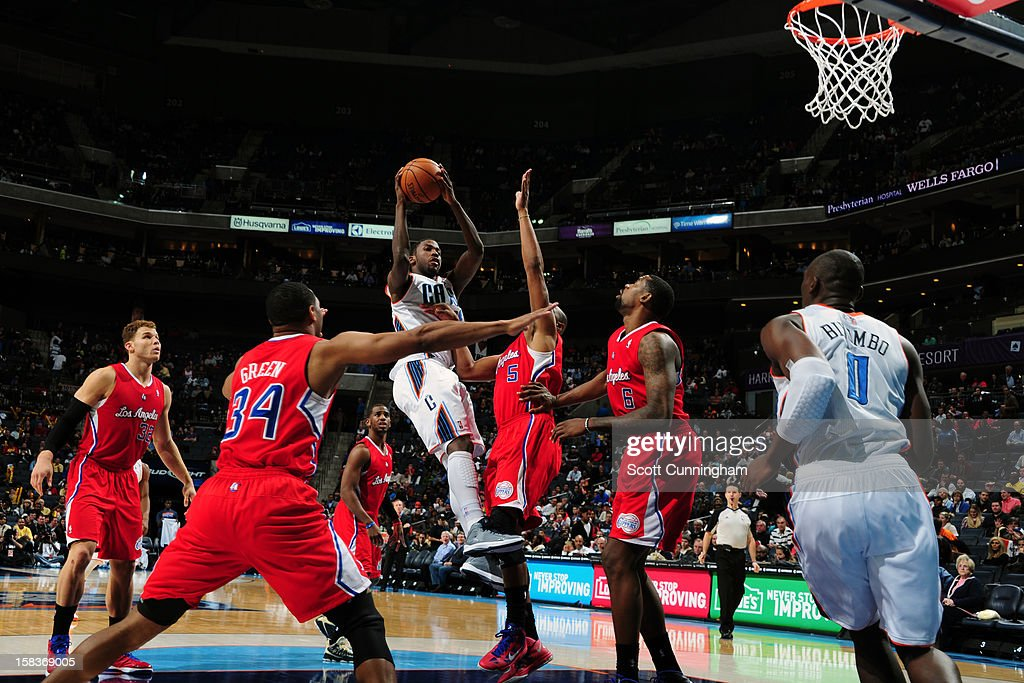 Michael Kidd-Gilchrist #14 of the Charlotte Bobcats looks to make a pass against the Los Angeles Clippers on December 12, 2012 at Time Warner Cable Arena in Charlotte, North Carolina.