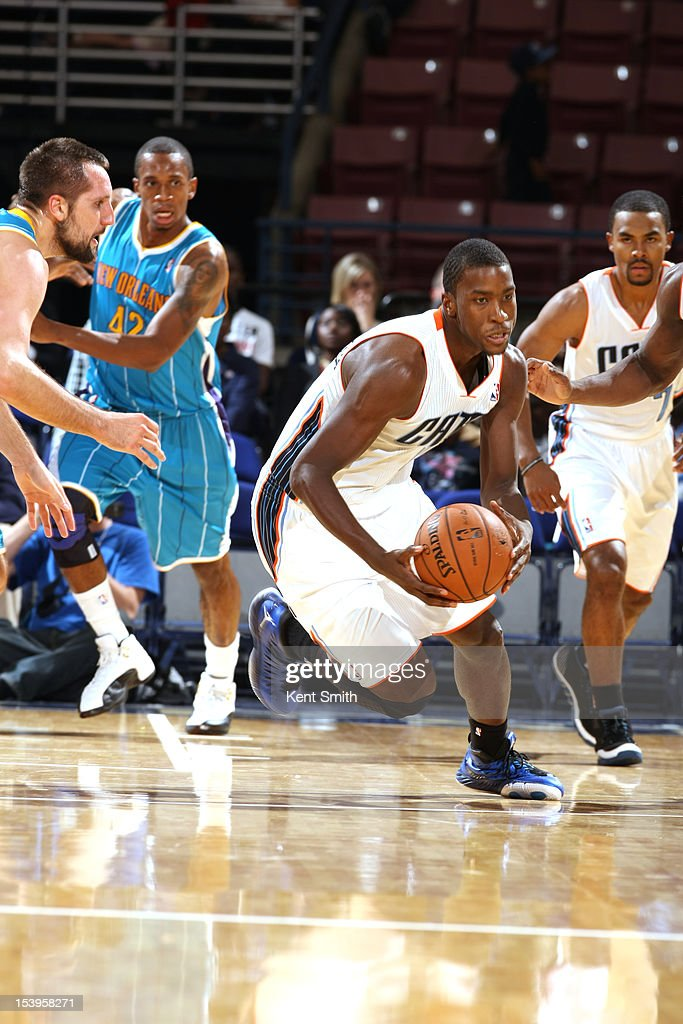 <a gi-track='captionPersonalityLinkClicked' href=/galleries/search?phrase=Michael+Kidd-Gilchrist&family=editorial&specificpeople=8526214 ng-click='$event.stopPropagation()'>Michael Kidd-Gilchrist</a> #14 of the Charlotte Bobcats makes the steal against Ryan Anderson #33 of the New Orleans Hornets at the North Charleston Coliseum on October 11, 2012 in North Charleston, South Carolina.