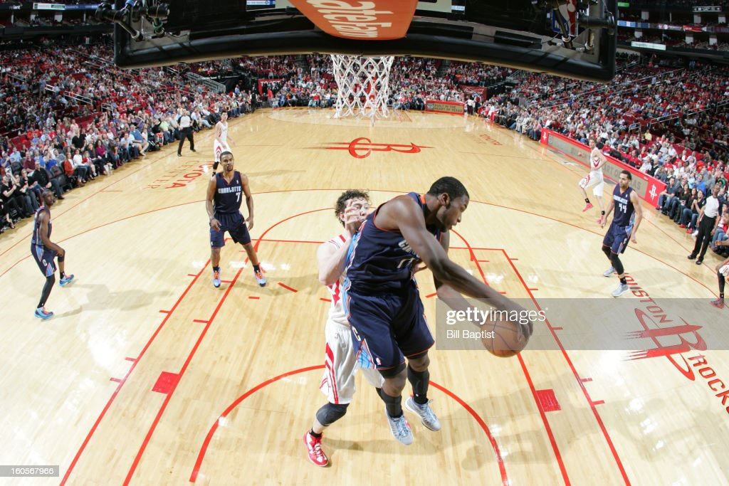 <a gi-track='captionPersonalityLinkClicked' href=/galleries/search?phrase=Michael+Kidd-Gilchrist&family=editorial&specificpeople=8526214 ng-click='$event.stopPropagation()'>Michael Kidd-Gilchrist</a> #14 of the Charlotte Bobcats rebounds against <a gi-track='captionPersonalityLinkClicked' href=/galleries/search?phrase=Omer+Asik&family=editorial&specificpeople=4946055 ng-click='$event.stopPropagation()'>Omer Asik</a> #3 of the Houston Rockets on February 2, 2013 at the Toyota Center in Houston, Texas.