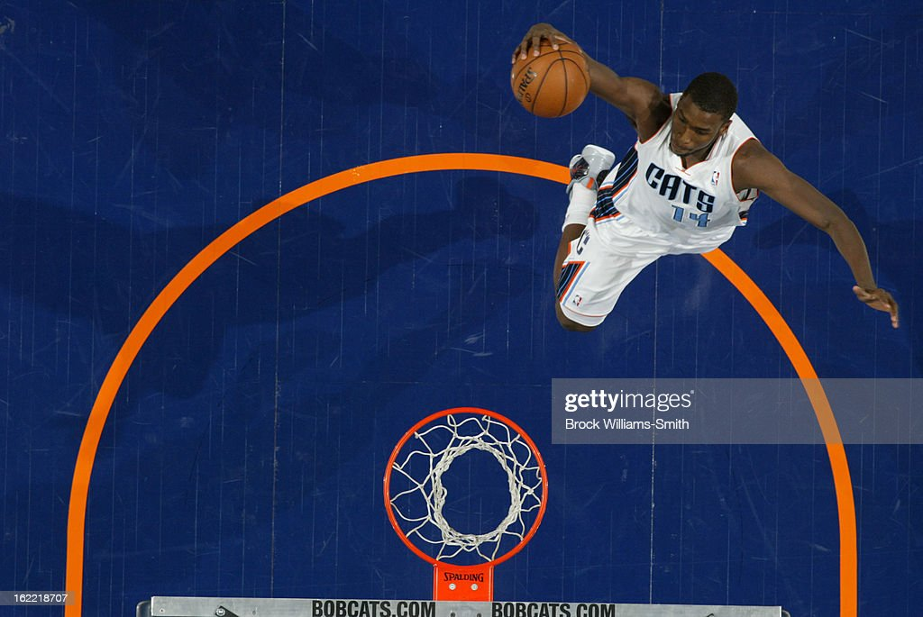 <a gi-track='captionPersonalityLinkClicked' href=/galleries/search?phrase=Michael+Kidd-Gilchrist&family=editorial&specificpeople=8526214 ng-click='$event.stopPropagation()'>Michael Kidd-Gilchrist</a> #14 of the Charlotte Bobcats rises for a dunk against the Detroit Pistons at the Time Warner Cable Arena on February 20, 2013 in Charlotte, North Carolina.