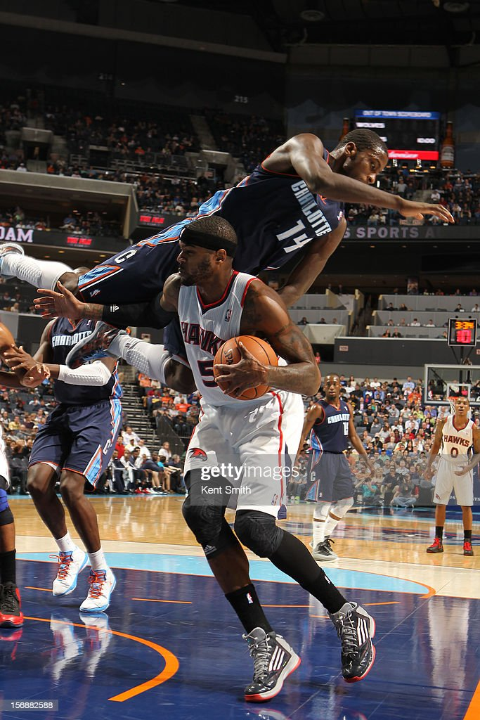 Michael Kidd-Gilchrist #14 of the Charlotte Bobcats sails over the head of Josh Smith #5 of the Atlanta Hawks at the Time Warner Cable Arena on November 23, 2012 in Charlotte, North Carolina.