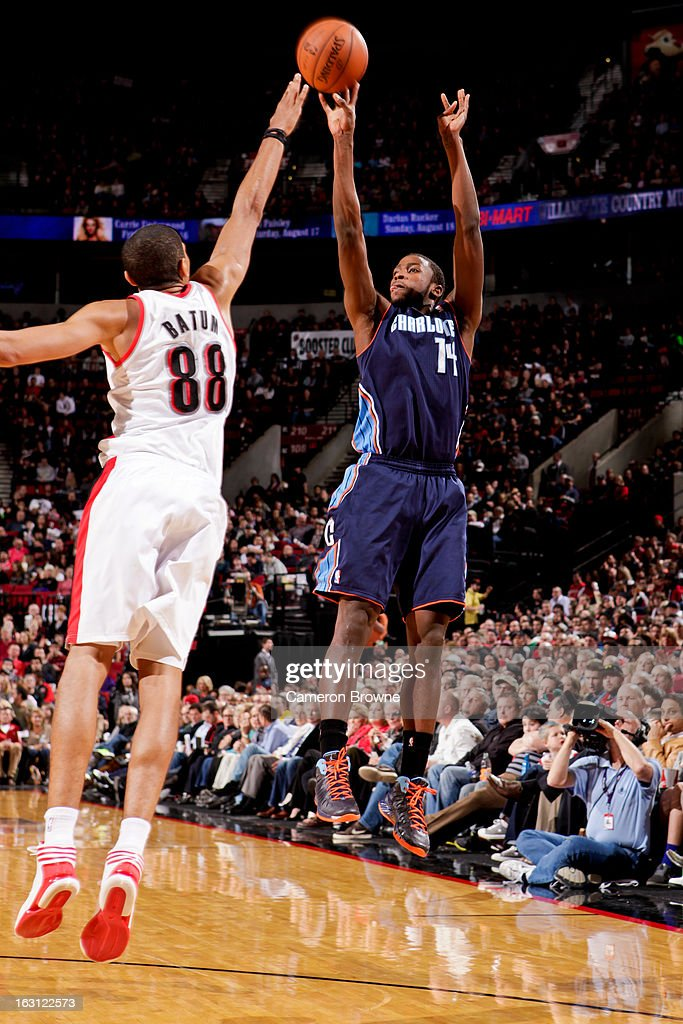 Michael Kidd-Gilchrist #14 of the Charlotte Bobcats shoots a three-pointer against Nicolas Batum #88 of the Portland Trail Blazers on March 4, 2013 at the Rose Garden Arena in Portland, Oregon.