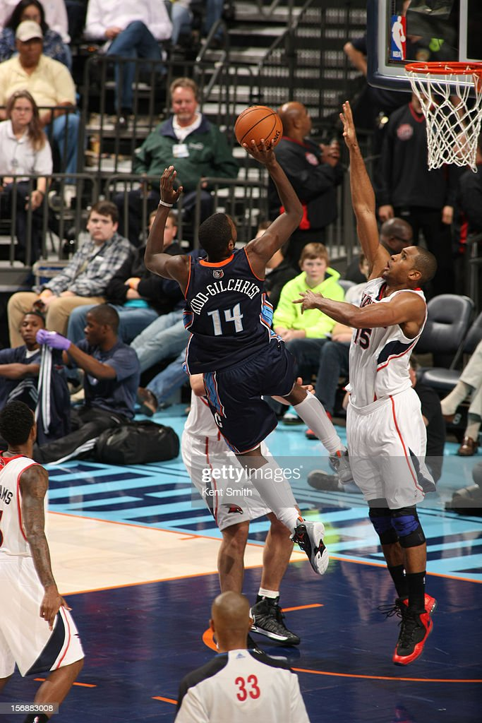 Michael Kidd-Gilchrist #14 of the Charlotte Bobcats shoots against Al Horford #15 of the Atlanta Hawks at the Time Warner Cable Arena on November 23, 2012 in Charlotte, North Carolina.