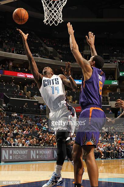 Michael KiddGilchrist of the Charlotte Bobcats shoots against Channing Frye of the Phoenix Suns during the game at the Time Warner Cable Arena on...