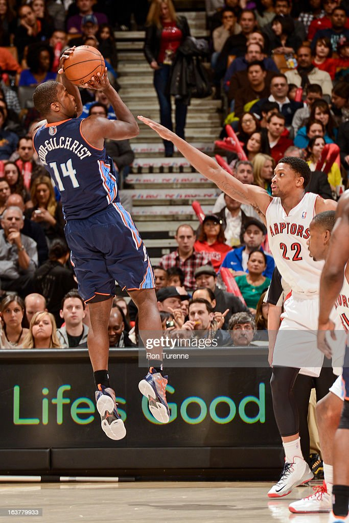 Michael Kidd-Gilchrist #14 of the Charlotte Bobcats shoots against Rudy Gay #22 of the Toronto Raptors on March 15, 2013 at the Air Canada Centre in Toronto, Ontario, Canada.