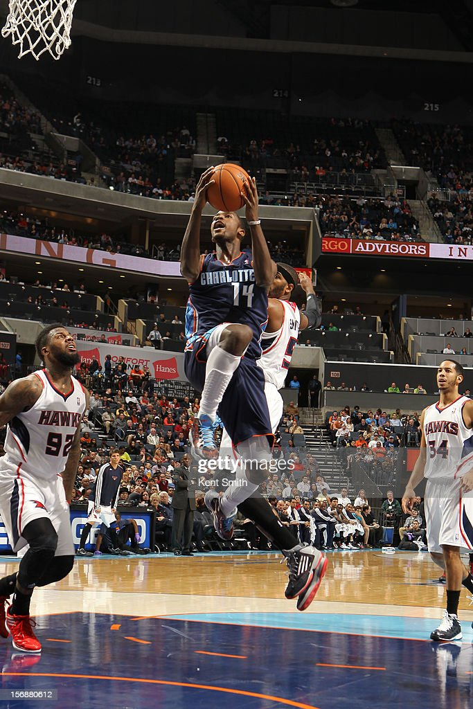 <a gi-track='captionPersonalityLinkClicked' href=/galleries/search?phrase=Michael+Kidd-Gilchrist&family=editorial&specificpeople=8526214 ng-click='$event.stopPropagation()'>Michael Kidd-Gilchrist</a> #14 of the Charlotte Bobcats shoots against the Atlanta Hawks at the Time Warner Cable Arena on November 23, 2012 in Charlotte, North Carolina.