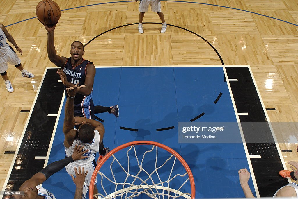 Michael Kidd-Gilchrist #14 of the Charlotte Bobcats shoots against the Orlando Magic on January 18, 2013 at Amway Center in Orlando, Florida.