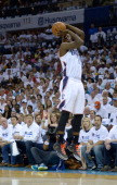Michael KiddGilchrist of the Charlotte Bobcats shoots against the Miami Heat in Game Three of the Eastern Conference Quarterfinals during the 2014...