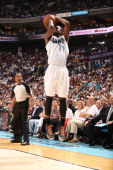 Michael KiddGilchrist of the Charlotte Bobcats shoots against the Miami Heat in Game Four of the Eastern Conference Quarterfinals in the 2014 NBA...