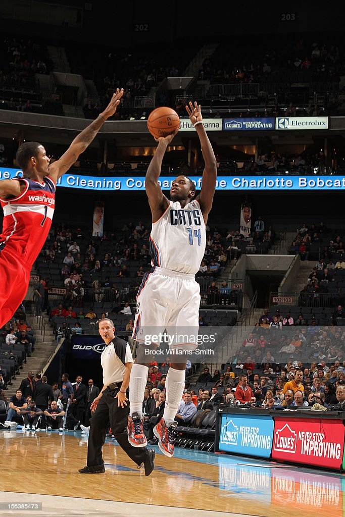 <a gi-track='captionPersonalityLinkClicked' href=/galleries/search?phrase=Michael+Kidd-Gilchrist&family=editorial&specificpeople=8526214 ng-click='$event.stopPropagation()'>Michael Kidd-Gilchrist</a> #14 of the Charlotte Bobcats shoots against <a gi-track='captionPersonalityLinkClicked' href=/galleries/search?phrase=Trevor+Ariza&family=editorial&specificpeople=201708 ng-click='$event.stopPropagation()'>Trevor Ariza</a> #1 of the Washington Wizards at the Time Warner Cable Arena on November 13, 2012 in Charlotte, North Carolina.