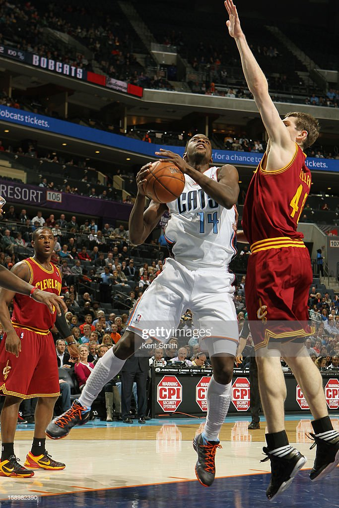 Michael Kidd-Gilchrist #14 of the Charlotte Bobcats shoots against Tyler Zeller #40 of the Cleveland Cavaliers at the Time Warner Cable Arena on January 4, 2013 in Charlotte, North Carolina.