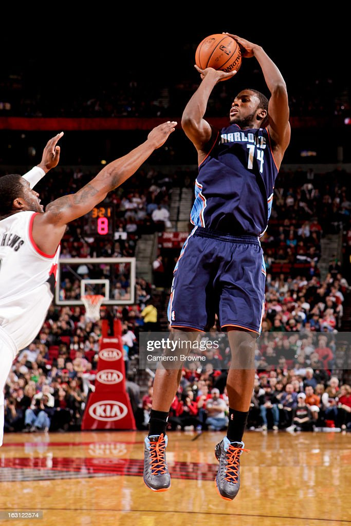 Michael Kidd-Gilchrist #14 of the Charlotte Bobcats shoots against Wesley Matthews #2 of the Portland Trail Blazers on March 4, 2013 at the Rose Garden Arena in Portland, Oregon.