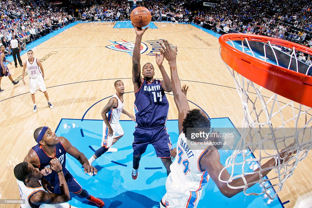 <a gi-track='captionPersonalityLinkClicked' href=/galleries/search?phrase=Michael+Kidd-Gilchrist&family=editorial&specificpeople=8526214 ng-click='$event.stopPropagation()'>Michael Kidd-Gilchrist</a> #14 of the Charlotte Bobcats shoots in the lane against <a gi-track='captionPersonalityLinkClicked' href=/galleries/search?phrase=Hasheem+Thabeet&family=editorial&specificpeople=4003778 ng-click='$event.stopPropagation()'>Hasheem Thabeet</a> #34 of the Oklahoma City Thunder on November 26, 2012 at the Chesapeake Energy Arena in Oklahoma City, Oklahoma.