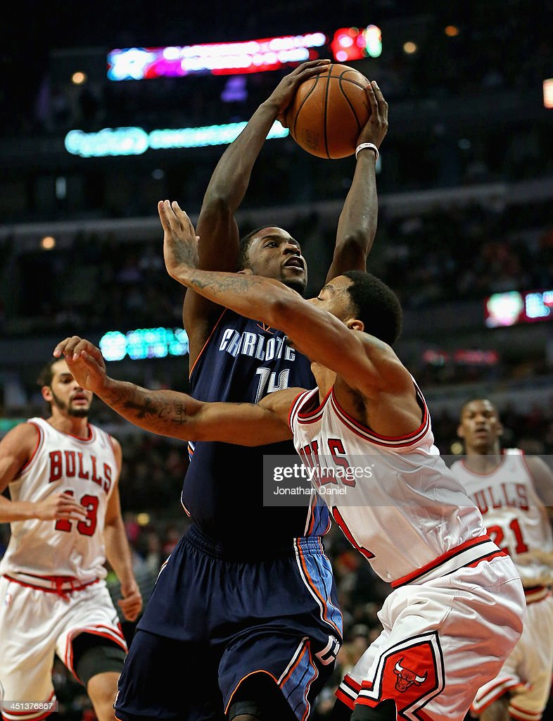 <a gi-track='captionPersonalityLinkClicked' href=/galleries/search?phrase=Michael+Kidd-Gilchrist&family=editorial&specificpeople=8526214 ng-click='$event.stopPropagation()'>Michael Kidd-Gilchrist</a> #14 of the Charlotte Bobcats shoots over <a gi-track='captionPersonalityLinkClicked' href=/galleries/search?phrase=Derrick+Rose&family=editorial&specificpeople=4212732 ng-click='$event.stopPropagation()'>Derrick Rose</a> #1 of the Chicago Bulls at the United Center on November 18, 2013 in Chicago, Illinois. The Bulls defeated the Bobcats 86-81.