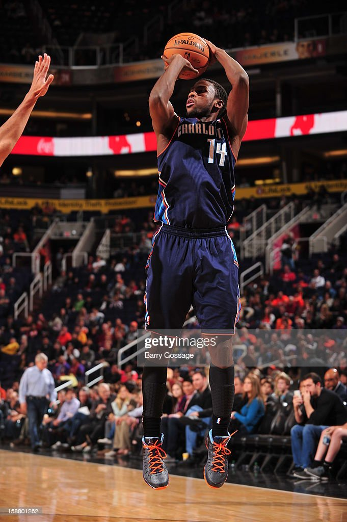 <a gi-track='captionPersonalityLinkClicked' href=/galleries/search?phrase=Michael+Kidd-Gilchrist&family=editorial&specificpeople=8526214 ng-click='$event.stopPropagation()'>Michael Kidd-Gilchrist</a> #14 of the Charlotte Bobcats shoots the ball against the Phoenix Suns on December 19, 2012 at U.S. Airways Center in Phoenix, Arizona.