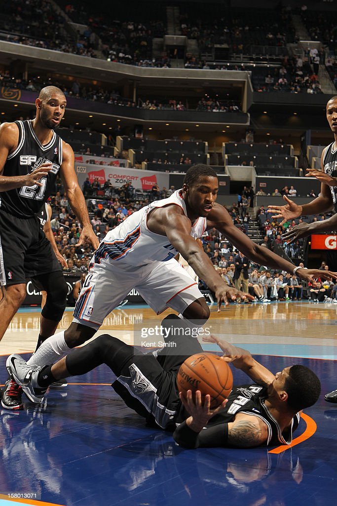 Michael Kidd-Gilchrist #14 of the Charlotte Bobcats strips the ball and keeps it away from the San Antonio Spurs at the Time Warner Cable Arena on December 8, 2012 in Charlotte, North Carolina.