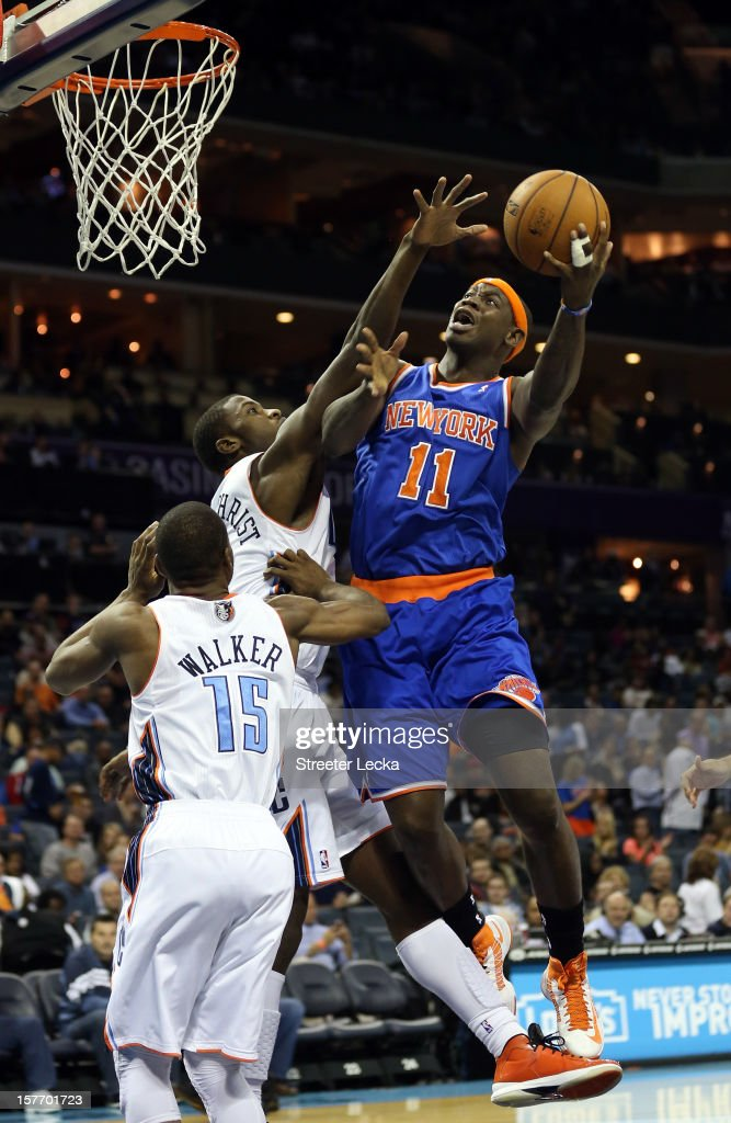 Michael Kidd-Gilchrist #14 of the Charlotte Bobcats tries to block Ronnie Brewer #11 of the New York Knicks during their game at Time Warner Cable Arena on December 5, 2012 in Charlotte, North Carolina.