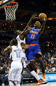 Michael KiddGilchrist of the Charlotte Bobcats tries to block Ronnie Brewer of the New York Knicks during their game at Time Warner Cable Arena on...