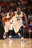 Michael KiddGilchrist of the Charlotte Hornets brings the ball up court against the Washington Wizards at Bon Secours Wellness Arena on October 10...