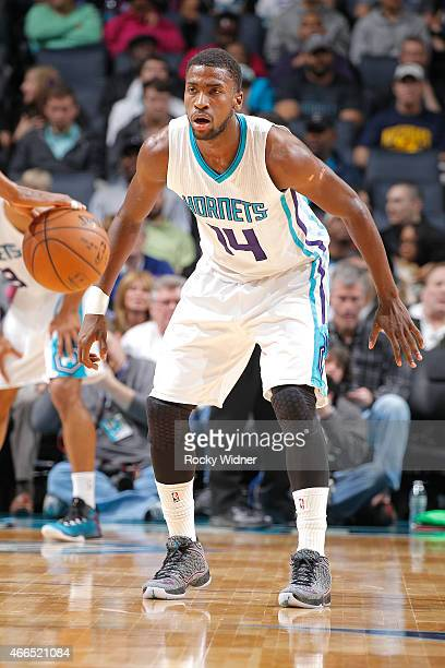Michael KiddGilchrist of the Charlotte Hornets defends the Sacramento Kings on March 11 2015 at Time Warner Cable Arena in Charlotte North Carolina...