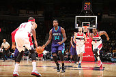 Michael KiddGilchrist of the Charlotte Hornets dribbles against Paul Pierce and John Wall of the Washington Wizards during a preseason game at the...
