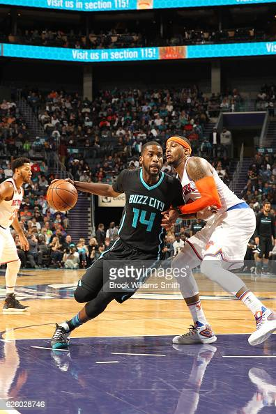 Michael KiddGilchrist of the Charlotte Hornets drives against Carmelo Anthony of the New York Knicks during the game at the Spectrum Center on...